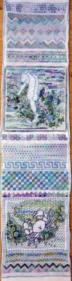 hand embroidered area of a needlework sampler