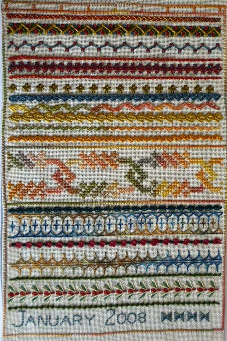 needlework sampler of hand embroidery