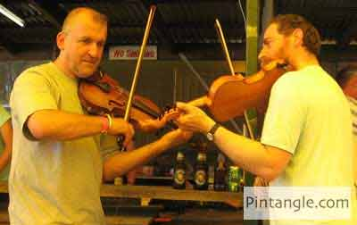 Fabric Postcard Dueling fiddlers source photo