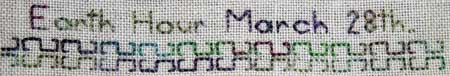 detail of back stitch on a hand embroidered needlework sampler