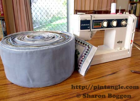 sampler roll next to the sewing machine