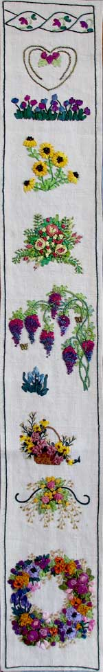 part of a hand embroidered band sampler