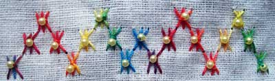 Sample of hand embroidered Sheaf Stitch