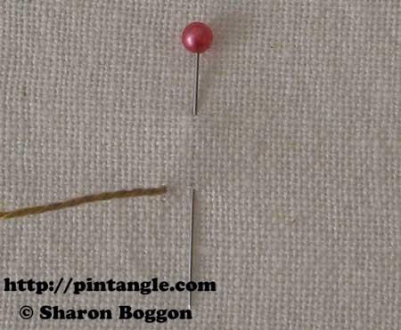 Open base needlewoven picot