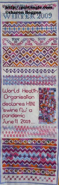 hand embroidered needlework sampler