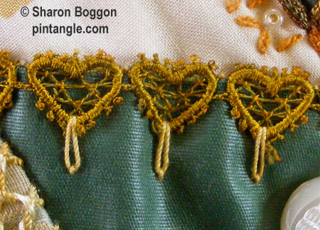 Crazy quilt hand embroidered seam detail with lace