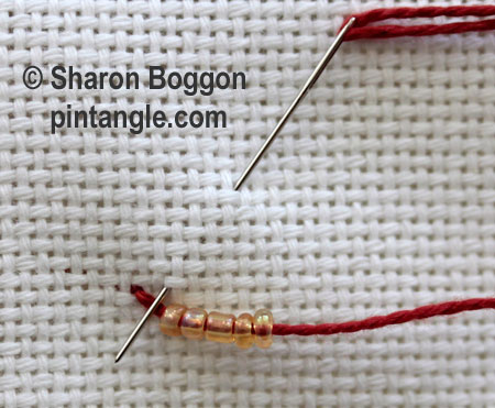 Triangular buttonhole and Beaded Triangular buttonhole stitch