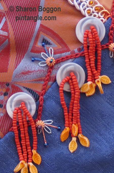 Button tassels on block 42