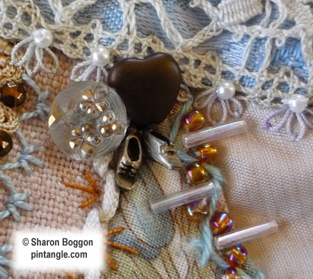 Crazy quilt detail of charms on block