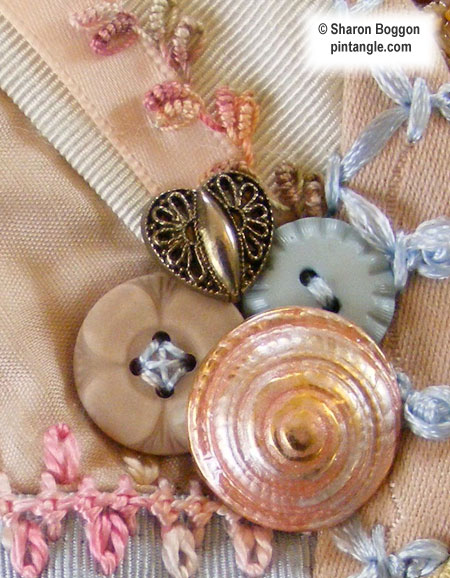 Crazy quilt detail of buttons on block