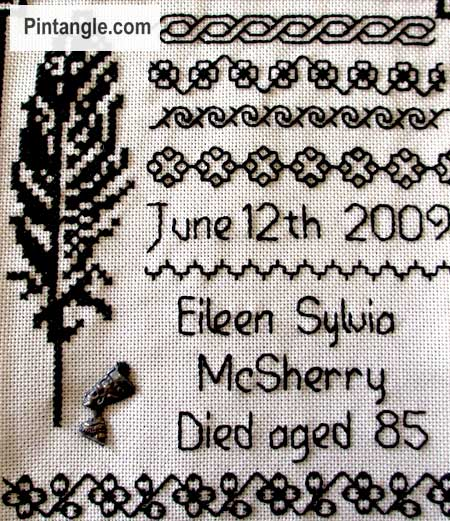 section of hand embroidered sampler with traditional patterns