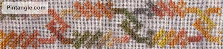 cross stitch sample worked in hand dyed threads