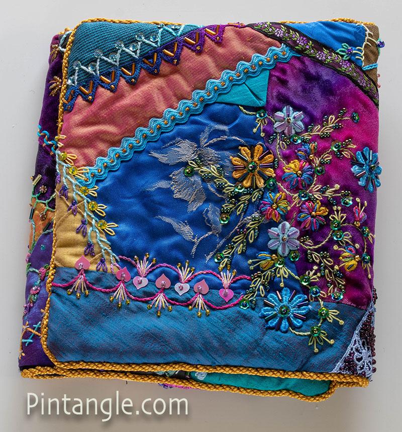 Jewel toned hussif back fold