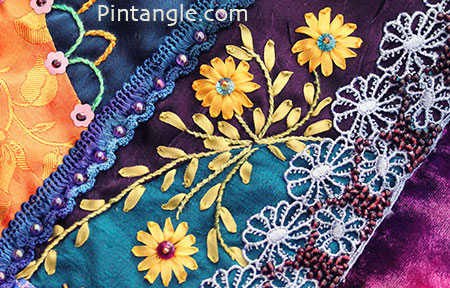 Jewel toned hussif silk ribbon embroidery detail